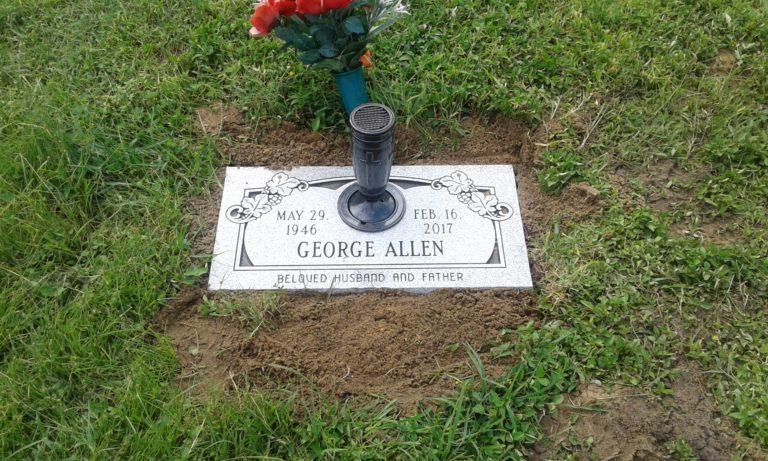 Gray memorial marker with vase, Hillsboro Memorial Gardens , Tampa, Fl