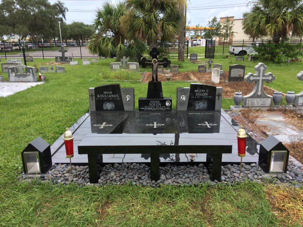 black granite lot with candlehouses and bench